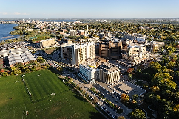 Aerial view of the Health Sciences Campus. In this photograph, the VA Hospital (right) connects to the UW Hospital (middle), American Family Children's Hospital (bottom right), UW Medical Foundation Centennial Building (MFCB, Right), Wisconsin Institutes Medical Research (WIMR, Left), Health Sciences Learning Center (HSLC, middle top) and Rennebohm Hall (Pharmacy Building, top left). Also included in picture, is the Waisman Center (bottom).