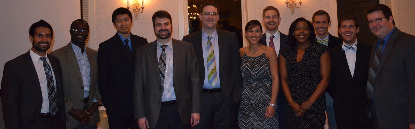 Residents attending the Chief's Graduation. Left to right: Vikas Parmar, M.D., Solomon Ondoma, M.D., Yiping Li, M.D., Kyle Swanson, M.D. Casey Madura, M.D., Carolina Sandoval-Garcia, M.D., Clayton Haldeman, M.D., Demi Dawkins, M.D., Mark Corriveau, M.D., Bradley Schmidt, M.D., Christopher Baggott, M.D.