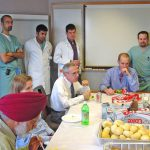 Dr. Chopp at lunch with residents and research staff