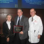 Dr. Dixon presented David Gilboe Lectureship plaque by Dr. Dempsey
