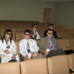 Residents using 3d glasses for lecture about 3d video in microscropes