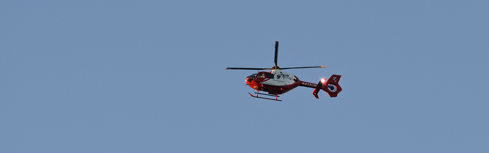 A UW Med Flight helicopter flies above the University of Wisconsin-Madison