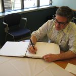 Dr. Rabkin signing the visitor book