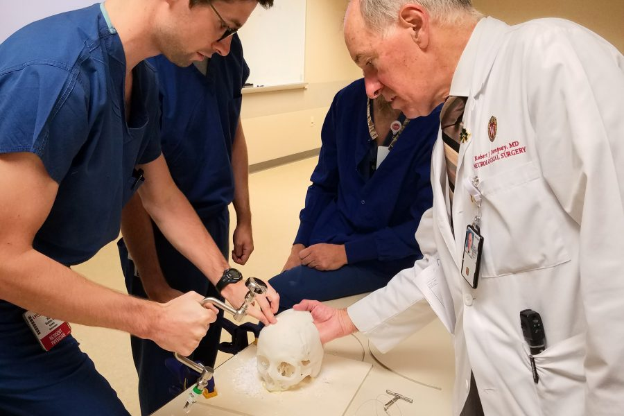 Robert J. Dempsey, MD (right) gives a hands-on surgical demonstration to our PGY 1 resident, Niall Buckley, MD.